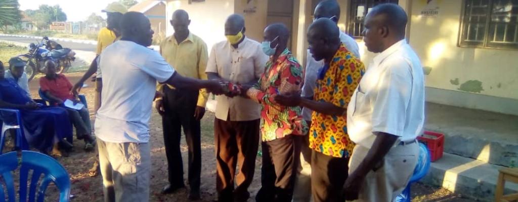 Emyooga money handover to the beneficiaries